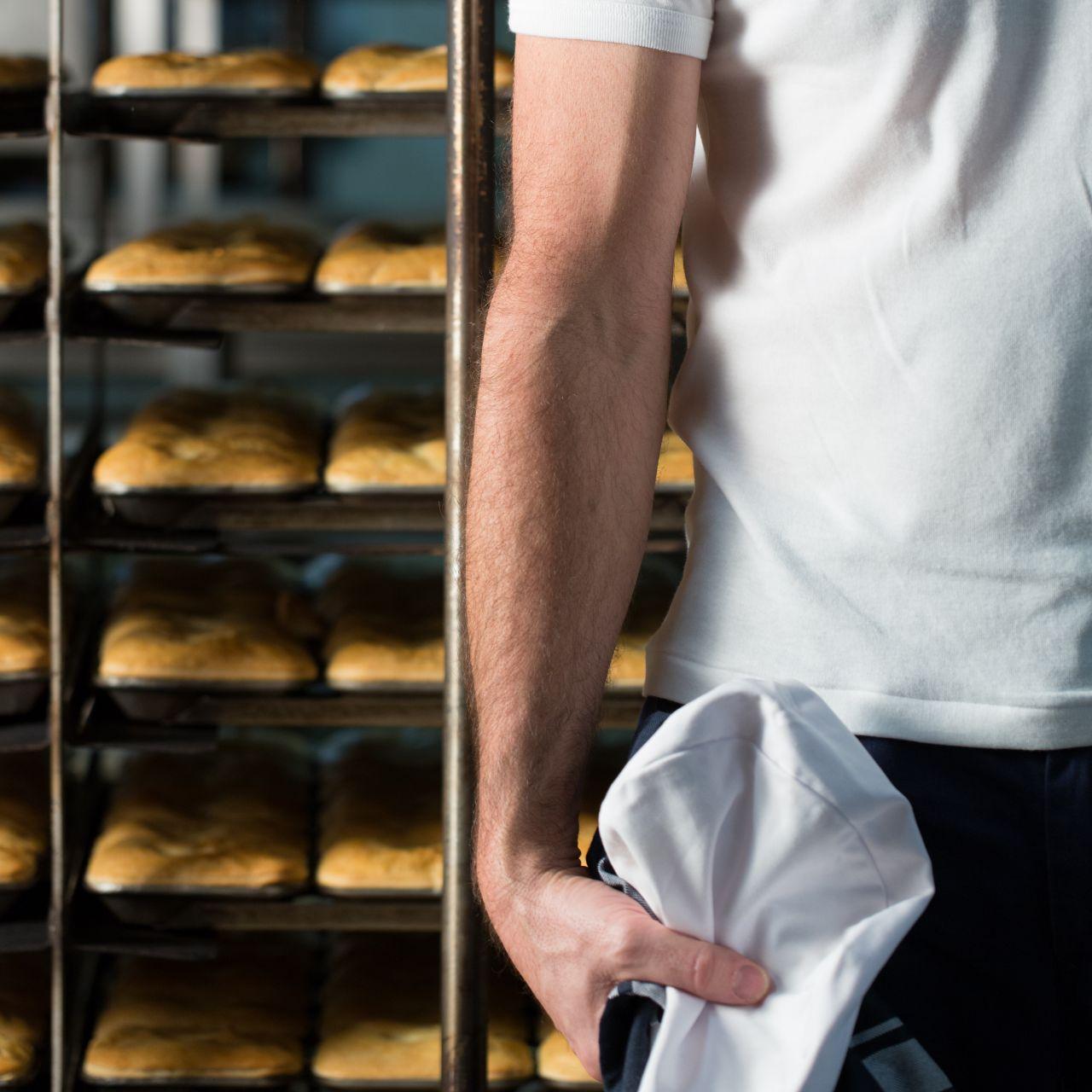 Baker holding hat